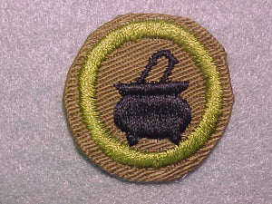 COOKING, MERIT BADGE WITH CRIMPED EDGE, TAN, ISSUED 1936-45