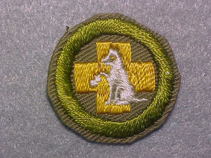 FIRST AID TO ANIMALS, MERIT BADGE WITH CRIMPED EDGE, TAN, ISSUED 1936-45