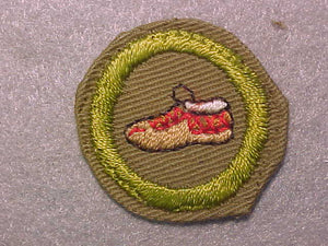 LEATHERWORK (MOCCASIN), MERIT BADGE WITH CRIMPED EDGE, TAN, ISSUED 1936-45