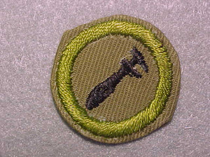 MACHINERY, MERIT BADGE WITH CRIMPED EDGE, TAN, ISSUED 1936-45