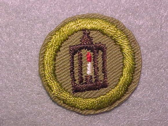 METALWORK, MERIT BADGE WITH CRIMPED EDGE, TAN, ISSUED 1936-45