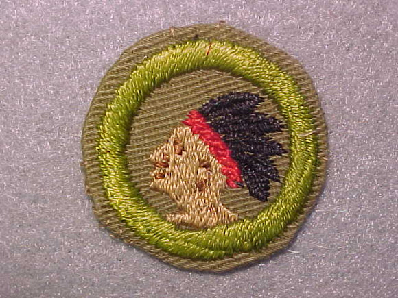 PATHFINDING, MERIT BADGE WITH CRIMPED EDGE, TAN, ISSUED 1936-45