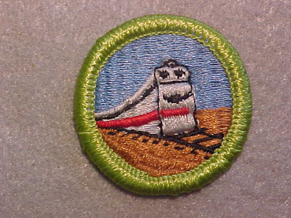 RAILROADING, MERIT BADGE WITH CLEAR PLASTIC BACK, GREEN BORDER, NO IMPRINTS/LOGOS IN PLASTIC