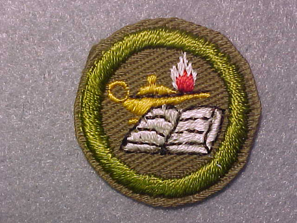 READING, MERIT BADGE WITH CRIMPED EDGE, TAN, ISSUED 1936-45