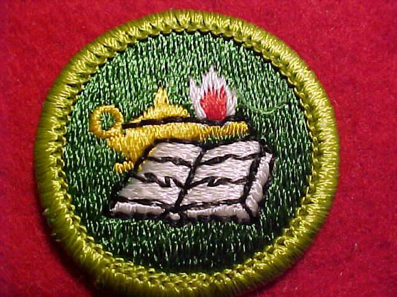 READING, MERIT BADGE WITH CLEAR PLASTIC BACK, GREEN BORDER, NO IMPRINTS/LOGOS IN PLASTIC, 1972-2002