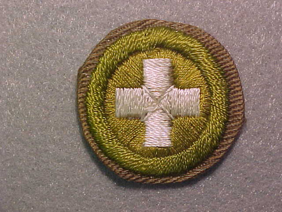 SAFETY, MERIT BADGE WITH CRIMPED EDGE, TAN, ISSUED 1936-45