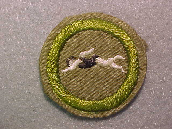 SWIMMING, MERIT BADGE WITH CRIMPED EDGE, TAN, ISSUED 1936-45