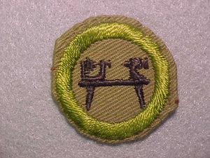 WOOD TURNING, MERIT BADGE WITH CRIMPED EDGE, TAN, ISSUED 1936-45