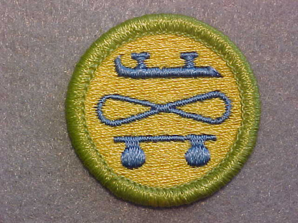 SKATING 1973-99, MERIT BADGE WITH CLEAR PLASTIC BACK, GREEN BORDER, NO IMPRINTS/LOGOS IN PLASTIC