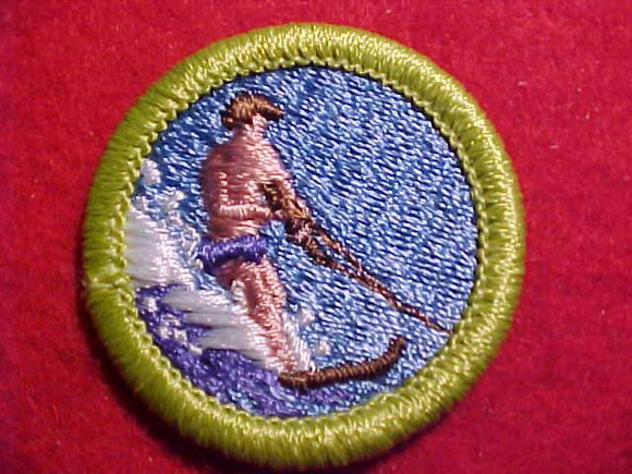 WATER SKIING, MERIT BADGE WITH CLEAR PLASTIC BACK, GREEN BORDER, NO IMPRINTS/LOGOS IN PLASTIC, 1972-95, NO LIFE JACKET