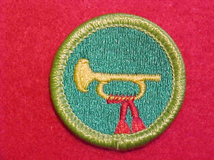 BUGLING, MERIT BADGE WITH CLEAR PLASTIC BACK, GREEN BORDER, NO IMPRINTS/LOGOS IN PLASTIC