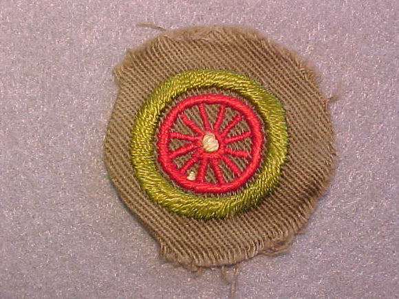 AUTOMOBILING MERIT BADGE, WIDE TAN BORDER, ISSUED 1932-36, USED