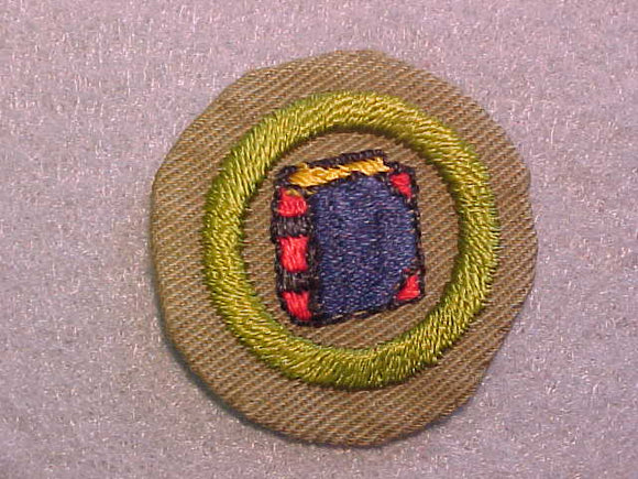 BOOKBINDING MERIT BADGE, WIDE BORDER CRIMPED, ISSUED 1932-36, USED