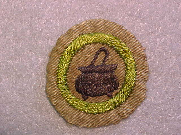 COOKING MERIT BADGE, WIDE BORDER CRIMPED, ISSUED 1932-36, USED