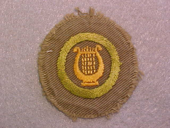 MUSIC MERIT BADGE, WIDE TAN BORDER, ISSUED 1932-36, USED