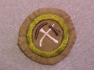 PIONEERING MERIT BADGE, WIDE BORDER CRIMPED, ISSUED 1932-36, USED