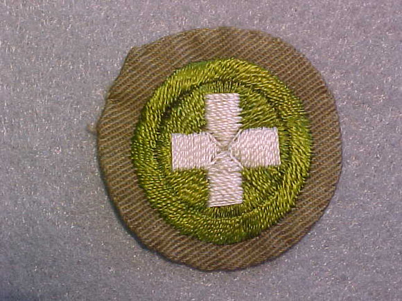 SAFETY MERIT BADGE, WIDE TAN BORDER, ISSUED 1932-36, USED
