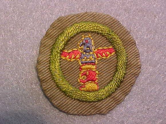 WOOD CARVING MERIT BADGE, WIDE BORDER CRIMPED, ISSUED 1932-36, USED