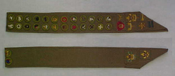 MERIT BADGE SASH, 1930'S, 24 MERIT BADGES INCLUDING RARE AVIATION BI-PLANE