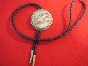 77 NJ bolo, braided black leather string, token emblem