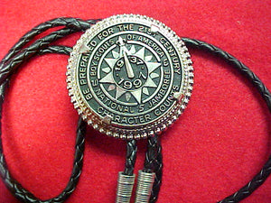 1997 bolo, token style, braided black leather string