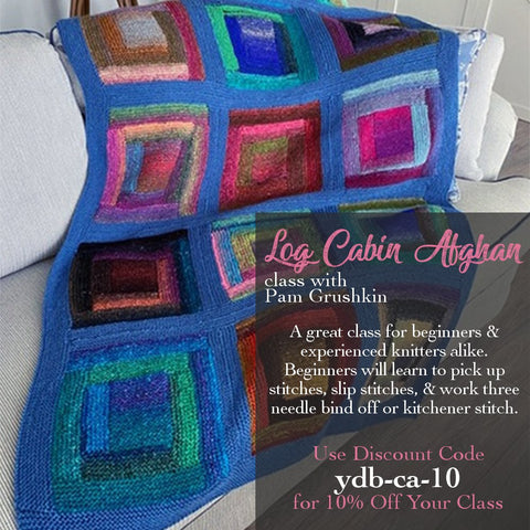 knitted log cabin throw in noro yarn designed by pam grushkin laying over the arm of a couch, with 10% off knitting class coupon code