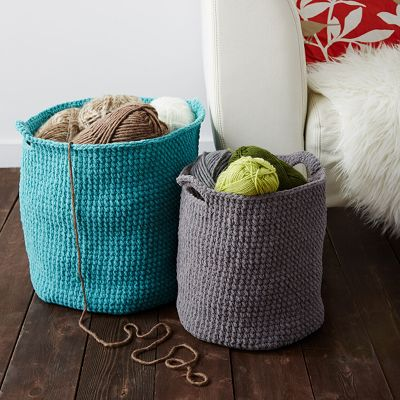 two crocheted storage baskets in teal and grey, available in two sizes
