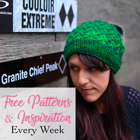 woman wearing emerald green hand knit beanie with lattice pattern and grey furry pom pom