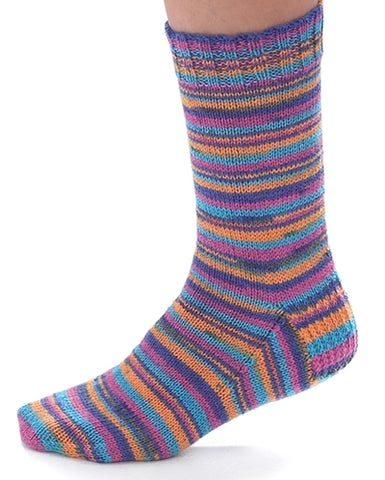 A simple basic knitted sock on a foot with lots of different thin color stripes in purple orang blue green. On a white background