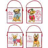 image of four cross stitch designs with hanging thread to hang them on the tree, with different breeds of dogs, and cute little sayings