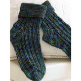 image of dark blue-green ridged socks with a stockinette heel and toe, the cuffs are knitted in a onby one rib