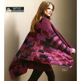 woman wearing a technicolor knit square jacket in shades of burgundy, pinks, reds and black