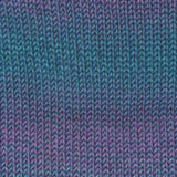 knitted swatch of painted sky yarn from knitting fever in 203 steel blue colorway. shades of medium blue, sea green and purple are plied together to create depth of color that gradually shifts from purple to blue green