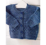a tiny cobalt blue kids cardigan rests on a hanger the main body is stockinette while the waist is an elegegant lace design. the neck, buttons, cuffs and waist are all ribbed