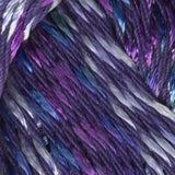 close up image of 9 ply yarn 6 strands are tightly plied royal purple , and 3 strands are loosely plied  and speckled in royal blue white and violet purple