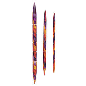 image of three knit picks cable needles in bright radiant colorway double pointed needles with notches along the needle in colors of purple yellow and red, in three sizes small, medium and large