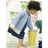 alice lace cardigan knitting pattern from louisa hardings enchanted garden book. a little girl is wearing a light blue knitted cardigan with eyelet pattern and white lace edging