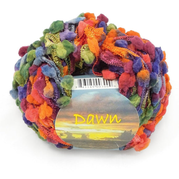 one ball of rainbow colored novelty yarn with a ribbon base and lots of fluffy pom poms attached