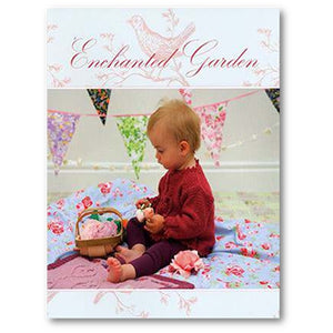 cover of louisa harding's enchanted garden childrens' knitting pattern book with a toddler sitting on a knitted blanket weith heart embellishments wearing a red knitted sweater with picot edges