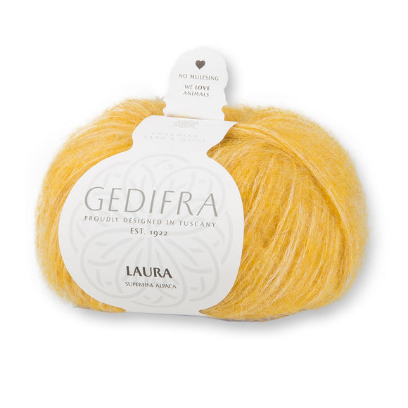 one ball of laura yarn by gedifra in light mustard yellow with white chainette strand haloed by super fine alpaca fibers
