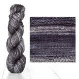 Urth Yarns composite image knitted swatch and twisted hank in colors of light and dark charcoal grey 3063