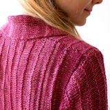 close up of the monokrom cardigan in shades of pink and red wine showing the shoulder joins and the collar stitching