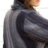 close up of the shoulder join on the monokrom cardigan showing the stitch detail of every few rows being a garter stitch