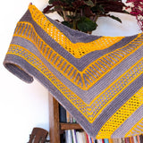 close up of triangle v shape of maya wrap in 2 colors yellow and blue with eyelet holes and brioche stitches