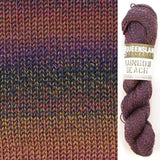 composit image of queensland collection rainbow beach showing a knitted swatch and an image of the yarn hank in colorway 102 pink dusk a deep rich mauve with orange and navy blue