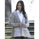 standing woman wearing alexandra cardigan a grey cardigan in simple stockinette stitch that flairs around the hips