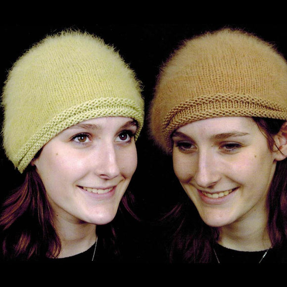 image of two girls wearing  knitted angora hats with a rolled edge in silk & merino wool, a plain stockinette stitch hat on a light citrus green and light brown