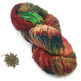 christmas red and green yarn with dark gold beads