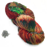 red and green christmas yarn with gunmetal grey beads