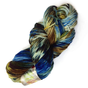 image of twisted hank of yarn with color splotches of sapphire blue, dark brown, medium brown, golden ochre, with pops of white